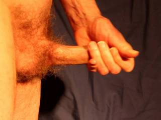 Of course I am often erect and my glans exposed as i am stroking my erection.