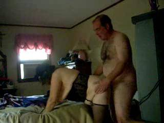 corset, stockings and top hat, bare ass and hard cock and tits falling out