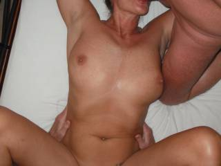Threesome fun with hubby and a swinger friend.