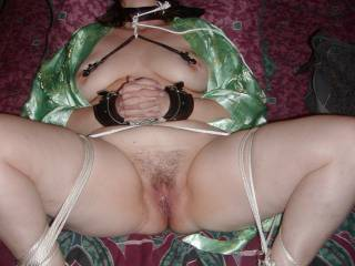 You look Gorgeous!  Nice Rope Work!  You look so sexy in cuffs with your nipples clamped and all tied up!  Would love to run your nipple chain through the piercing in my balls, and watch you suck my thick pierced cock while blindfolded!