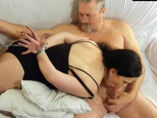Wife is sucking this guy off while he observes her hands taped nice and tight behind her back