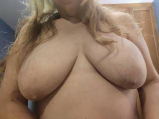 Hubby says he loves when my long hair flows over my huge tits. He says that it makes for a great cum target. Would like to cum on my tits, too?