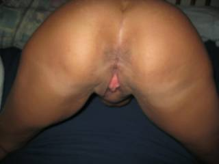 What a hot, sexy ass and pussy!!  Love to kiss, lick, suck and tongue her from behind and taste her!!
