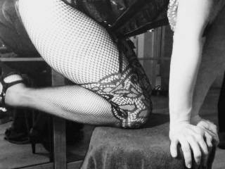 A little leg shot with new body stocking and tightly laced black leather corset.