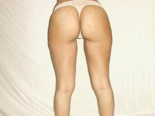 that is a perfect ass, you have great legs and those heels just make that ass that much better.  It looks like you have something stuck in there, mind if I get it out with my teeth?