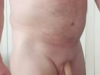Naked with cock hanging.