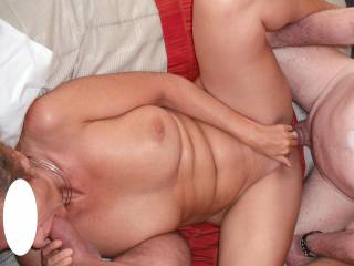 A great threesome with our swinger friend fucking me deep and hard with his extra thick cock and my hubby with his lovely cock in my mouth.  I reach down and play with my clit.  What more does a lady want?