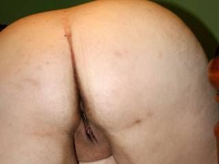 Hot Ass !!!! a spanking till its Red?  those sweet  Holes need something too :)