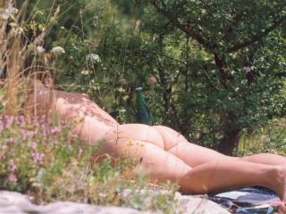 She takes her clothes off in public park enjoying the sun and desires of young men having wet dreams.