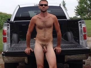 Oh shit. now that's what I call a sexy man with a delicious cock. I'll join you on that tailgate as long as I get to suck that cock anytime I want it.  Great picture....I love a naked picture of a man with a sweet cock like yours. MILF K