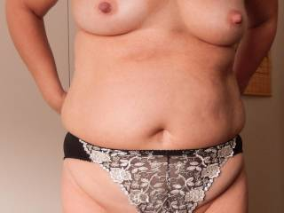They look so sexy I would leave them on, they just need to be pulled to the side to enjoy her pussy, beautiful big nipples too, what a gorgeous lady she is.