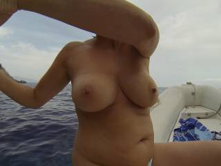 I'd love to let you wank my cock and make me cum all over your lovely tits before you jump in the water.