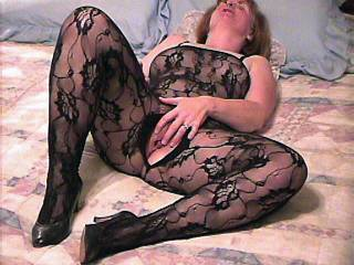 Mona poses for you in her body stocking...crotch-less fingering her clit