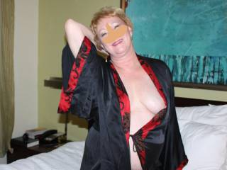 Opps...that perky left nipple got caught in her robe.  Can you help?