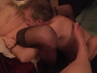 Licking my wife's pussy while our girlfriend takes some pictures and gets wet watching. Her turn is next!