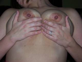 Holding my tits as I ride hubbys hard cock