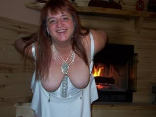 I'd like it better if she was dangling it in my face!  They really add nicely to those incredible tits.