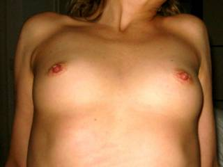 these are gorgeous tits that I would like to cover with my mouth, my dick, my cum...