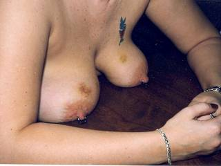 my breasts after a long night with my nipples chained to the bedposts.