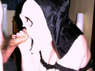 Wife in Scream mask blowing friend