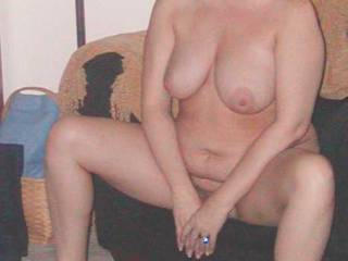 The sexy hanging tits, the teasing slutty face, and lovely inviting pussy. Mmmmm....