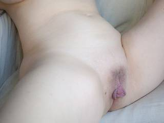 just relaxing and showing off her smooth yet curvy look; of course those lips are distracting