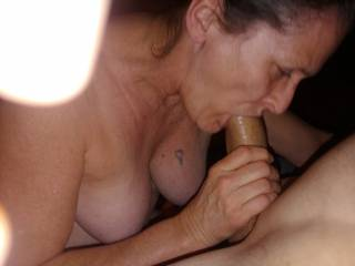 Sucking my Cock before I buried it deep in her Pussy.