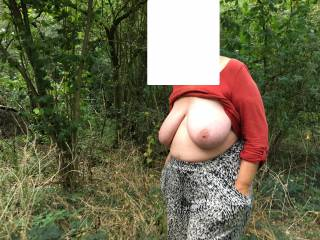 Action picture - walking along a footpath, hands in pockets, tits out