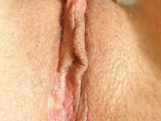 Great looking pussy and lovely lips.  Would love to suck on that big clit.