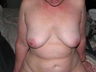 I like your wife's tits. I'd love to suck on em and then fuck her mouth