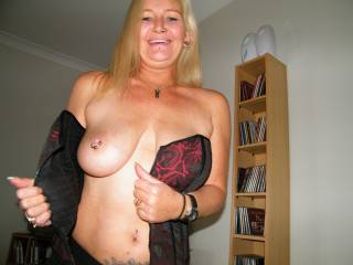 Cute face and your tits are just beautiful.  Love the piercings too.  Very hot pic.