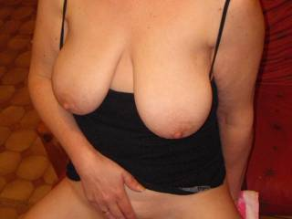 hmm felt good dildo in my pussy, tits out on show ....now cover me boys with your white stuff ...