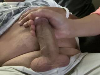 Wife stroking my cock for me