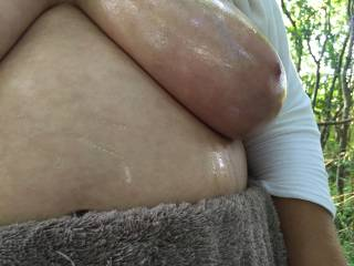 Just her left tit - nicely oiled - including some streaks that ran off it on to her belly