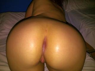 Ass up after a wild night of sex. I was left with cum dripping out of my tight ass after an anal pounding. What a lucky girl!