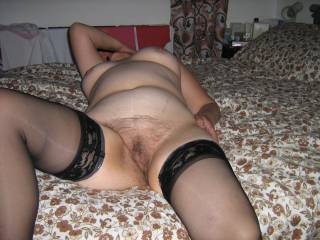 Looking so sexy in those stockings Kath, and that hairy pussy always gets me horny, just love your fabulous mature body.
