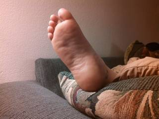 My nine month pregnant wifes foot after work