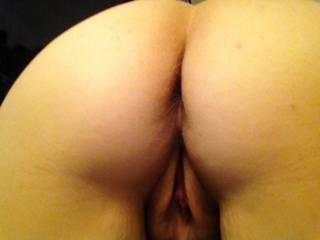 That is SO awesome! I love the view of a naked ass and a pussy showing from under it.  And your cheeks are so awesome I can picture my tongue running from the top of your ass to the top of your pussy over and over and over! I love this shot!!!!!