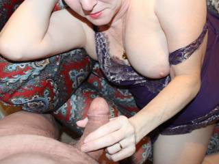Sexy pic looks like she is enjoyin having that cock in her hand love them titties bet they are fun to fuck and to shoot a load on wouldnt mind seein that