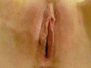 Close up of my shaved pussy. Nice and wet inside after being fucked