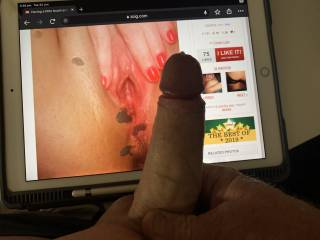 Checking out photos and cumming