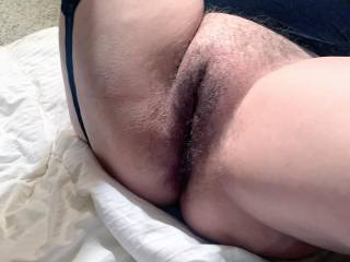 Just a nice shot of my ex's full, wet, hairy pussy.