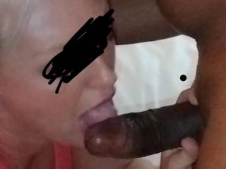 Licking that black cock up and down!