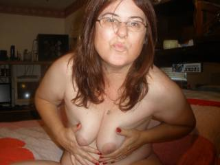 I'd love to see you looking up at me with those glasses on as my cock is in your mouth while my wife watches