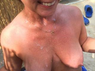 My wife\'s tits and face covered with my juices