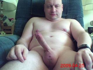 I'm relaxing nude with an erection!