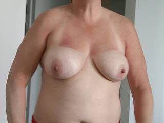 The wife getting ready for the beach. Should she go topless?