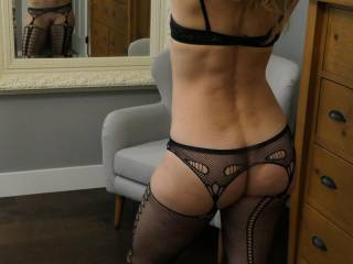 I can only imagine how horny she makes guys at work wearing things like this!!  Her ass is so fucking amazing!!  What do you think she gets up too?
