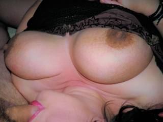 Showing my tits for the cameraman aka hubby, while giving his friend a good sucking mmmmm