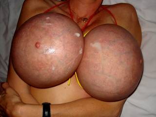 Those tits are enormous. I'd need six balls to have enough cum to cover those huge jugs.